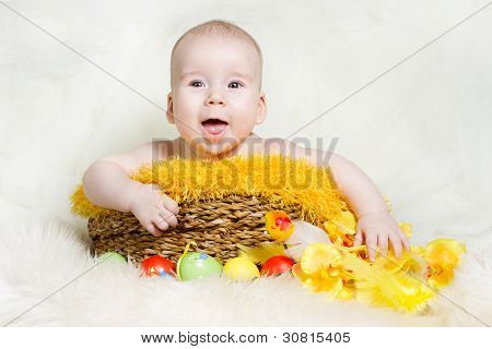 Happy Baby In Easter Basket With Eggs