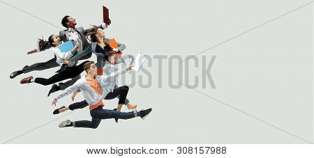 Happy Office Workers Jumping And Dancing In Casual Clothes Or Suit With Folders Isolated On Studio B