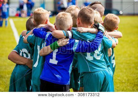 Boys' Sports Team Huddling. Children Playing Sports In A Team. Team Sports For Kids. Children Sports
