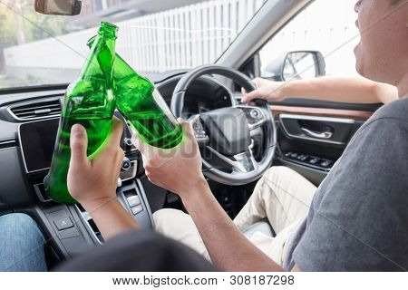 Don't Drink For Drive Concept, Young Drunk Man Drinking Bottle Of Beer Or Alcohol During Driving The