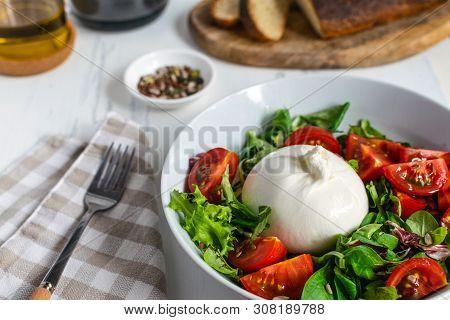Fresh Salad With Italian Burrata Cheese, Juicy Tomatoes, Balsamic Vinegar And Olive Oil