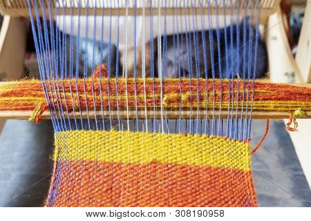 Weaving Loom With Knitted Throw. Vintage Wooden Loom Handmade. Close Up