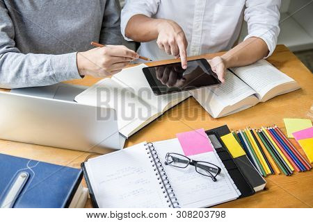 Education, Teaching, Learning Concept. High School Students Or Classmates Group Tutor In Library Stu