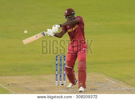 Carlos Brathwaite of West Indies battingMANCHESTER, ENGLAND. 22 JUNE 2019:   The West Indies v New Zealand, ICC Cricket World Cup match, at Old Trafford, Manchester, England.