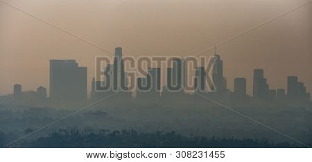 Los Angeles Skyline And Suburbs Wrapped In Smoke From Woosle Fires In 2018
