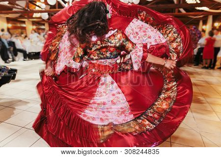 Beautiful Gypsy Girls Dancing In Traditional Red Floral Dress At Wedding Reception In Restaurant. Wo