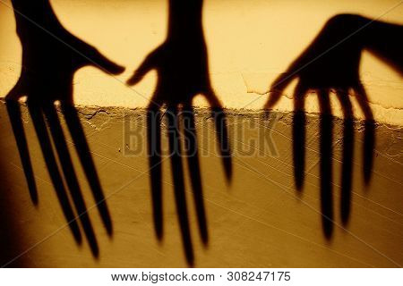 Strange Shadow On The Wall.terrible Shadow. Abstract Background. Black Shadow Of A Big Hand On The W