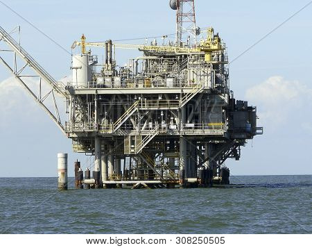 Oil Rig Near Dauphin Island, Alabama, Co-exists With Nature. This Natural Gas Field In Mobile Bay Is