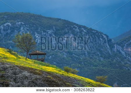 Man Resting Inside The Wooden Scenic Lookout And Shelter In Meteora Valley, Trikala Region, Greece
