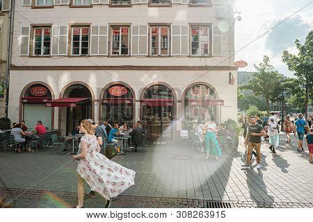 Strasbourg, France - July 22, 2017: Rue Des Grandes Arcades Street With Brioche Doree Cafe Facade Wi