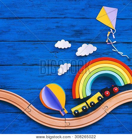 Wooden Toy Train, Railway For Preschool Child, Wood Rainbow, Paper Crafts On Blue Table. Waldorf Or