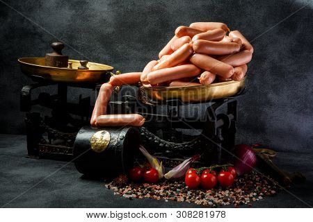 Pile Of Appetizing Long Thin Wieners On Antiquarian Scales