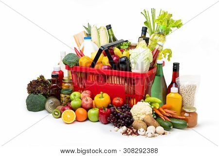 Red Supermarket Shopping Basket Full Of  Fresh Organic Colorful Foods And Groceries With Assorted In