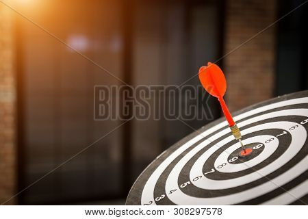 Red Dart Target Arrow Hitting On Bullseye With,target Marketing And Business Success Concept - Image