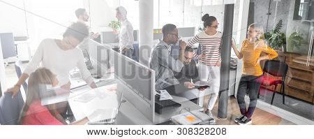 Team At Work. Group Of Young Business People Working Together In Creative Modern Office.