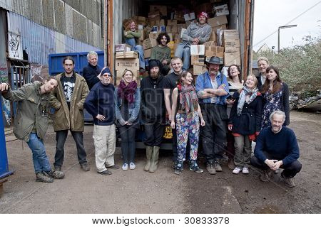Member of the Exeter based organisation BookCycle stand by thier loaded container before it leave fo