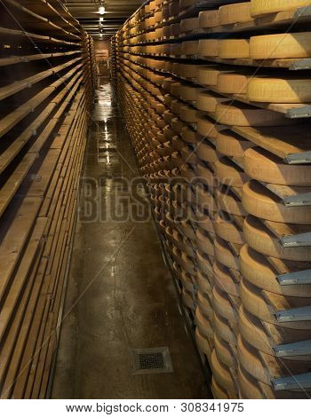 Greyerz, Vd / Switzerland - 31 May 2019: The Cellar In The Gruyeres Cheese Museum And Factory Used F