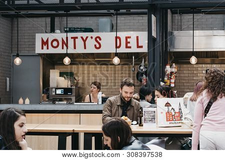 London, Uk - June 15, 2019: People Enjoying In Front Of Montys Nyc Style Deli Stand At Spitalfields