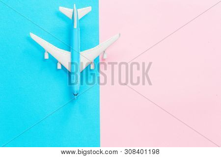 Blue Toy Airplane On Light Blue And Pink Matching Color Background. Flat Lay With Copy Space For Air