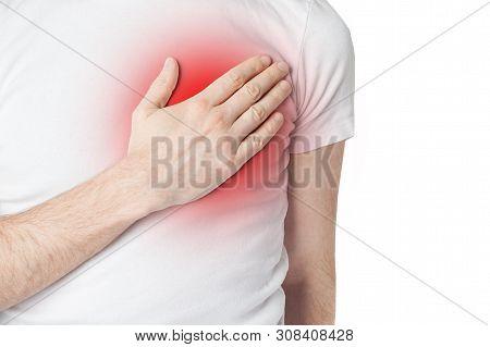 Man In White T-shurt Having Heart Pain. Man Holding His Hand To His Chest And Having Heart Pain