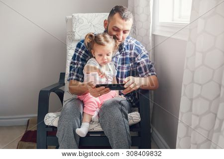 Caucasian Bearded Father Dad Sitting With Daughter Girl Child Watching Cartoons On Smartphone Digita