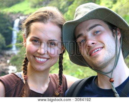 Hiking Couple With Waterfall
