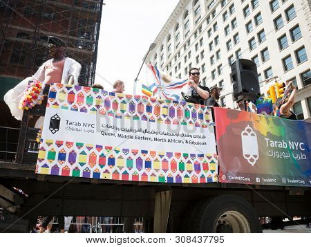 2018 JUNE 24 NEW YORK: NYC Pride March participants ride on the Tarab NYC float, a non-profit inclusive organization for Arab, Middle Eastern, and North African people, MENA, on 5th Ave.