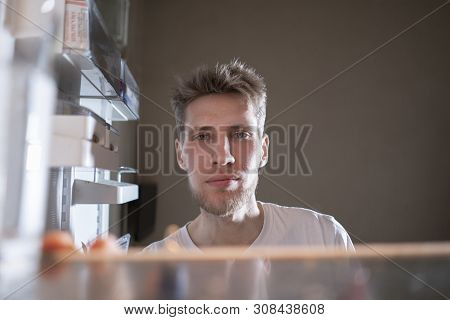 Hungry Man Looking For A Snack In The Fridge At Night, View From The Fridges