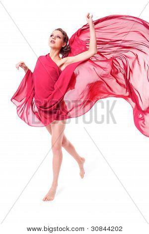 Beautiful Woman In Red Flying Dress