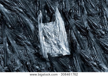 White Plastic Bag On Texture Of Black Plastic Bags, Plastic Waste Overflowing The City