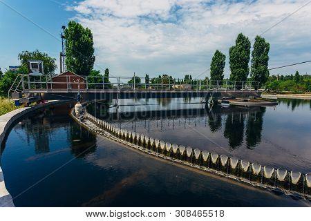 Modern Urban Sewage Treatment Plant. Sedimentation Drainage Tank Round Form.