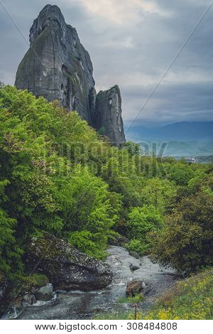 Small Stream Flowing Through The Impressive Rock Formations And Landscape At Meteora, Trikala Region