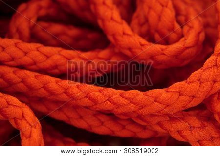 Red lace braided Hank macro photography as background. poster