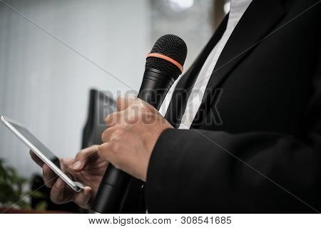 Speaker Or Businessman Hold Microphone For Speech Or Speaking In Seminar Conference Room, Talking Fo