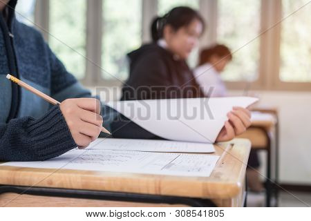 Group Of Asian Girl High School, University Student Having Test Exams For Taking Writing Examination