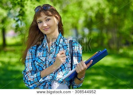 Summer Holidays, Education, Campus And Teenage Concept - Smiling Female Student With Folders
