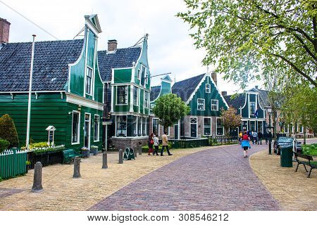 Zaandam, Holland - May 11: People Visit Old Traditional Houses At Zaanse Schans On May 11, 2013 In Z