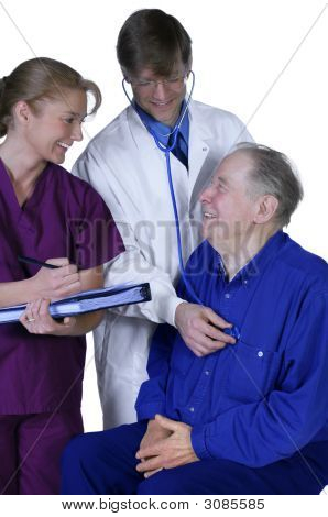 Doctor And Nurse Examining Elderly Patient