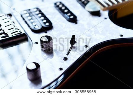 Close Up Of Modern Electric Guitar On Black Background.