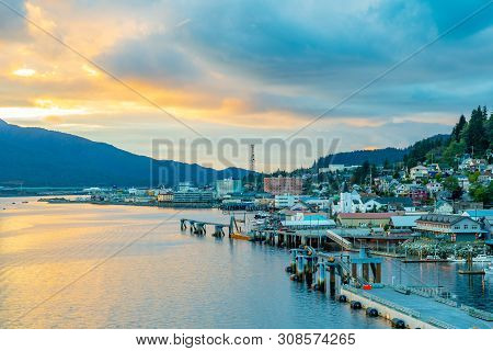 Sunset From The Coast In Ketchikan, Alaska. Landscape Coastal View Along The Ocean With Buildings Al