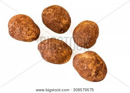 Potatoes isolated on white, top view.  Unwashed organic sebago variety.