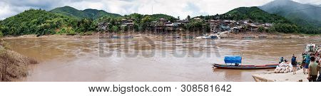 Muang Khua, Laos - August 14: Small Village And A Ferry On August 14, 2012 In Muang Khua, Laos. Muan