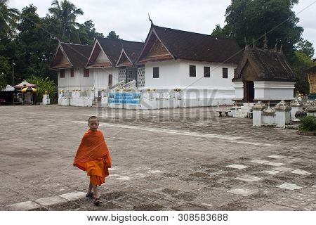Luang Prabang, Laos - August 17: Unidetified Child Buddhist Monk In  Wat Xieng Thong Temple On Augus