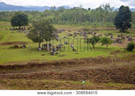 Phonsavan, Laos - August 8: Tourists Visit Plain Of Jars On August 8, 2012 In Phonsavan, Laos. Plain