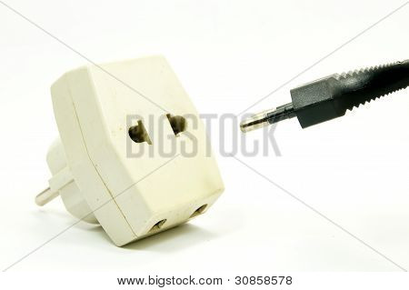 white outlet and black plug on white background