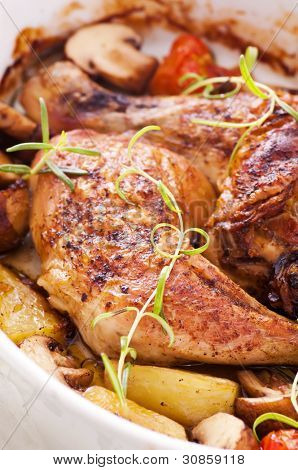 Chicken legs roasted with vegetables