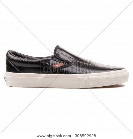 Vienna, Austria - August 25, 2017: Vans Classic Slip On Croc Leather Black Sneaker On White Backgrou