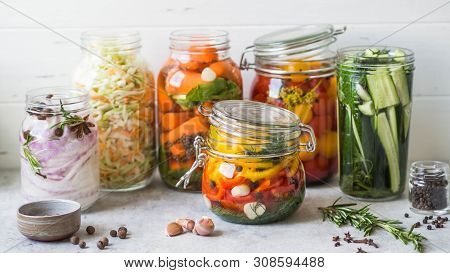 Pickled Vegetables. Salting Various Vegetables In Glass Jars For Long-term Storage. Preserves Vegeta
