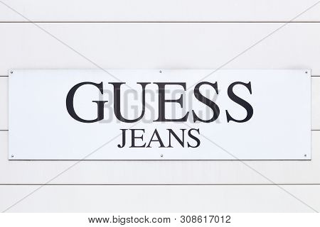 Aint Egreve, France - June 16, 2019: Guess Logo On A Wall. Guess Is An American Clothing Brand And R