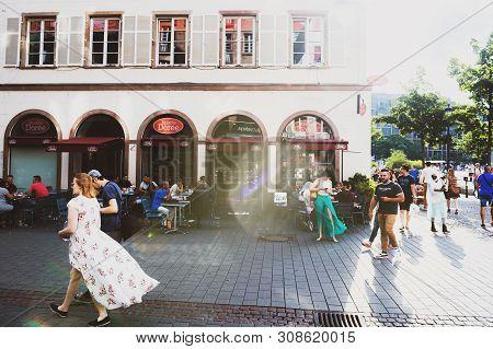 Strasbourg, France - July 22, 2017: Street Scene On Rue Des Grandes Arcades Street With Brioche Dore